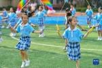 9月2日,长沙市天心区仰天湖桂花坪小学二年级的学生在体育课上跳绳。新华社记者 陈泽国 摄 - 新浪湖南